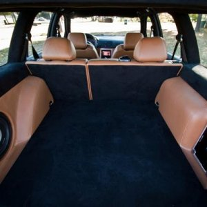 I borrowed this pic from a Google search.... this is kinda what I'm going for with regard to the subwoofer and amp in the cargo area, minus the uphols